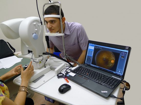 Tele-retina Screening test being done on patient