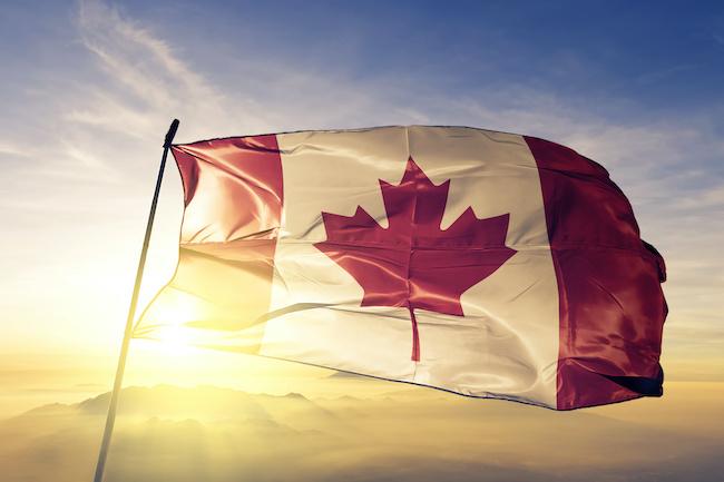 Canada Canadian flag textile cloth fabric waving on the top sunrise mist fog